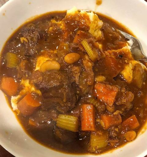 Beef Stew served over Mashed Potatoes